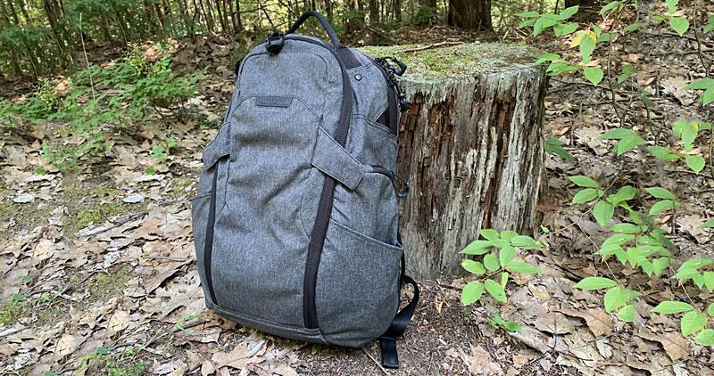 Maxpedition Entity 27 Backpack Against a Log